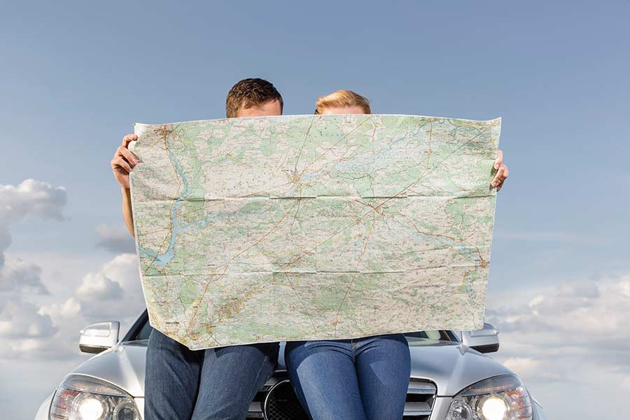 Couple holding a map planning a long-distance move