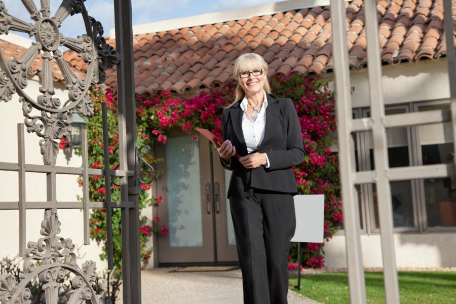 Real estate agent outside of home for sale