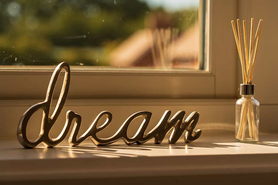 "Sign reading ""dream"" in a new home"